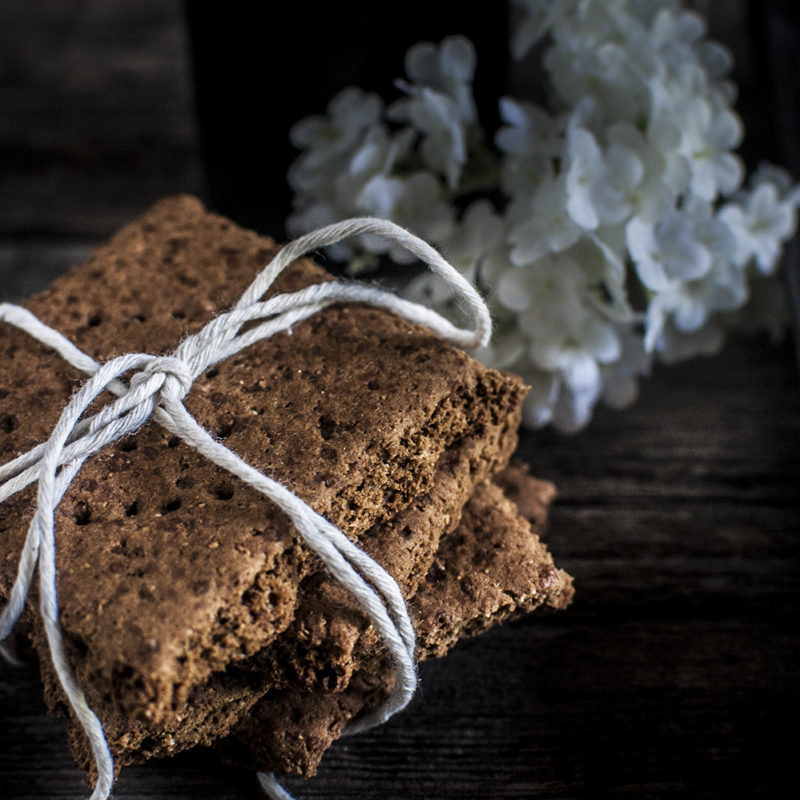 Paleo Graham Crackers - Golden, oven baked Paleo Graham Crackers are a staple in many dessert recipes. Perfect for children and adults with food allergies, so you can experience the joy without the guilt. #paleo #certifiedpaleo
