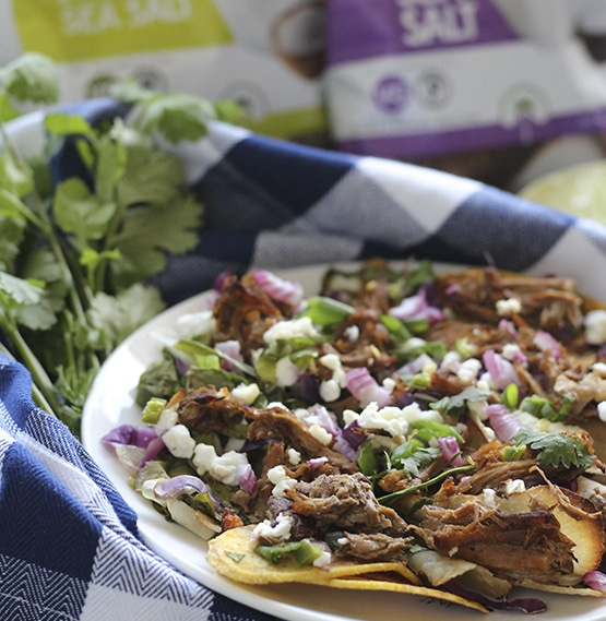 Pulled Pork and Goat Cheese Nachos - Artisan Tropic is a family with a passion for making the best tasting and most nutritious plantain and cassava chips. Artisan Tropic Plantain Strips and Cassava Strips contain only three ingredients or less! They have no preservatives or artificial flavors. #paleo #certifiedpaleo #paleovegan