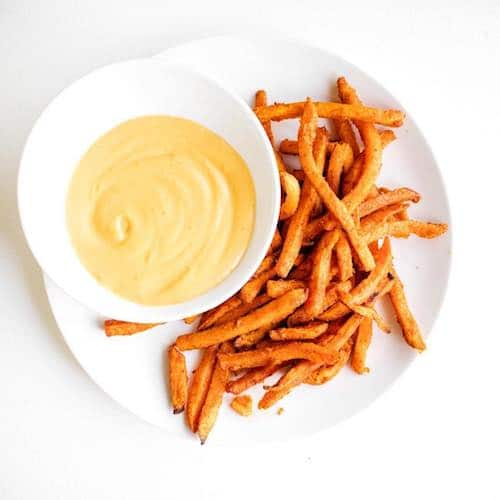 baked sweet potato fries and The Honest Stand cheese style dip - The Honest Stand - Certified Paleo, Paleo Vegan - Paleo Foundation