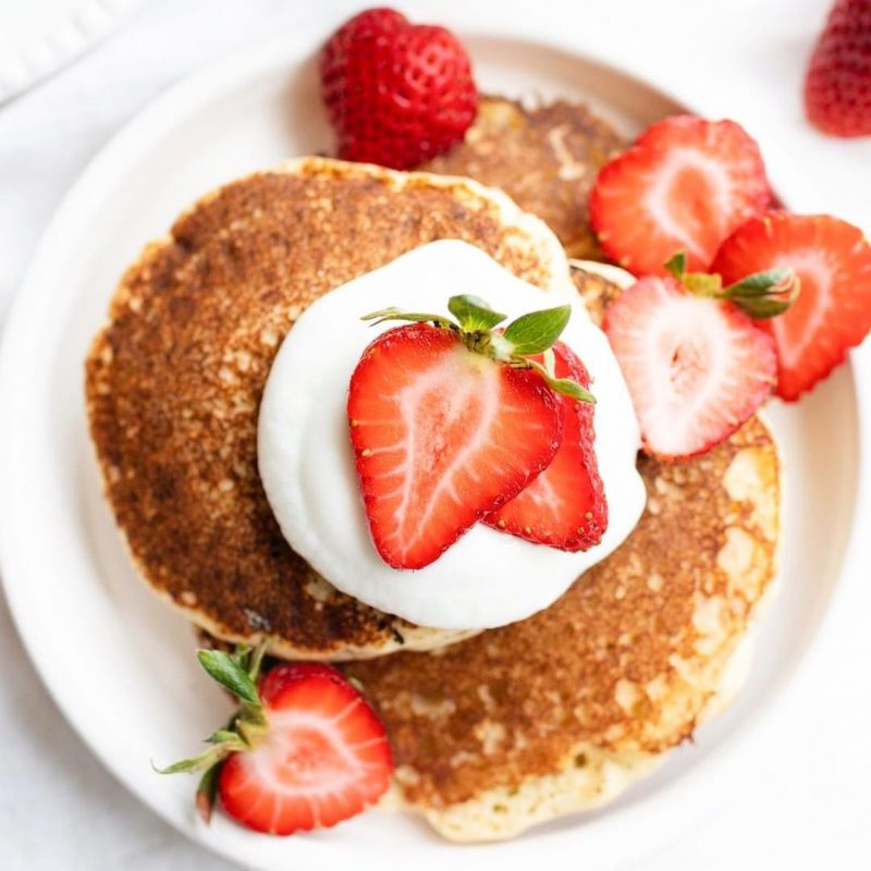 Pancakes topped with Strawberries - Birch Benders by the Certified Paleo by the Paleo Foundation